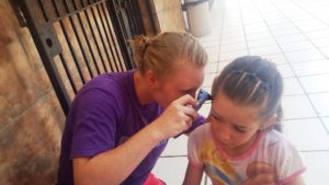 Mackenzie learned how to use an otoscope in her audiology class